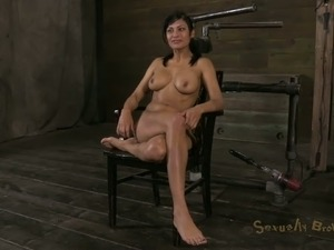 Oiled busty belted MILF deepthroats her master's massive dick