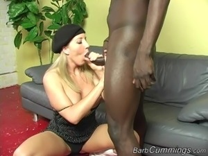 Busty blonde milf gets penetrated with a big black cock doggy style