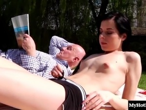 Mature guy with the shaved head gives the cutie an outdoors treatment