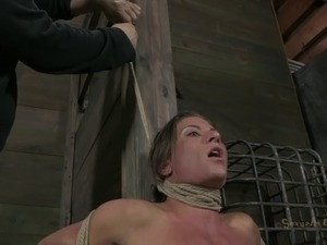 Woman with a shaved cunt is having a blast during a BDSM game