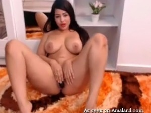 Sensational and sassy latina camgirl masturbates and flashes her big tits