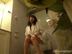 Busty Japanese babe came to take a piss but instead she masturbates