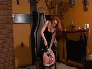 Redhead mistress spanks an ultra-tall skinny blonde