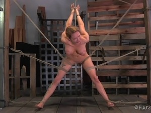 Seductively spread and spanking shoot of bondage babe in BDSM