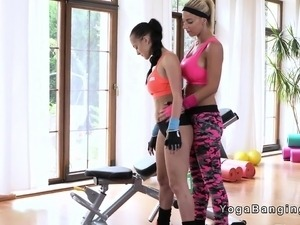 Busty lesbian trainer licks brunette in the gym