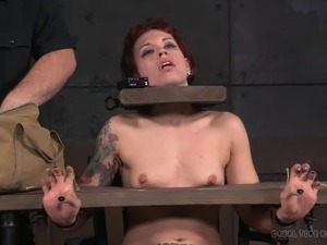 Short-haired babe with the red hair and the hard BDSM action
