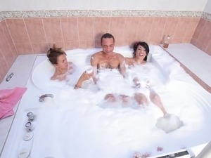 Dude with giant dick is going to fuck two ladyboys in the jacuzzi