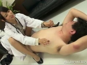 Dude gets tied up by a hot Japanese doctor and gets a footjob