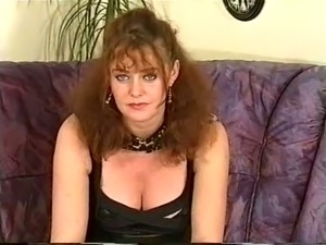 Redhead mature white lady in black dress on the couch