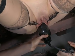 Her legs are tied up and fixated so a bondage master can play with her pussy