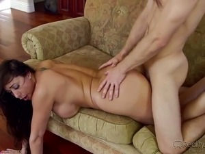 Cock hardening brunette MILF enjoys blowing fat long cock on sofa