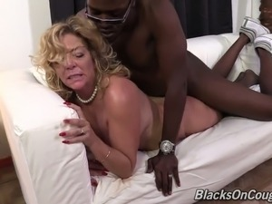 Mature curvaceous white blondie spreads her legs for a black man