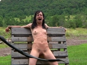 Anorexic brunette hussy gets her slender body tied up to wooden fence outdoors