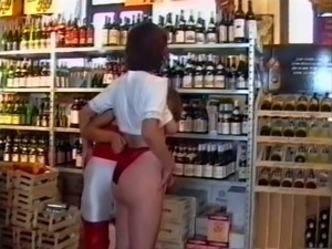 Blondie and brunette girl playing with each other in the store