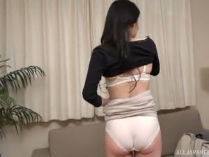 Stunning Japanese beauty takes off her clothes for kinky fun