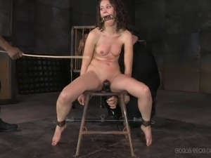 Sexy chick in a cage treated to an amazing BDSM session