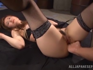 Naughty Japanese pornstar in fishnet stockings getting her hairy pussy...