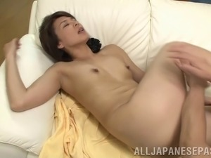 Sultry Asian cougar with small tits getting her hairy pussy fingered