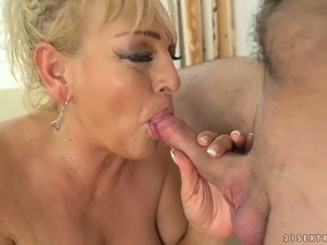 Despite her age this mature whore is still hot and she loves young men