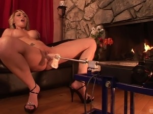 Slut fires up the dildo machine to fuck her pussy and ass