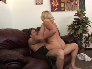 MILF with big tits gets drilled doggystyle and orgasms in a couples clip