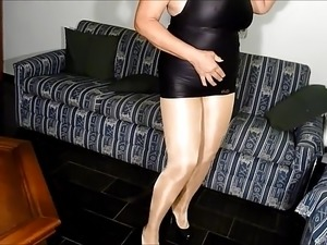 Sexy granny in shiny pantyhose