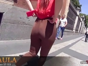 Hot girl in tights walks around the city