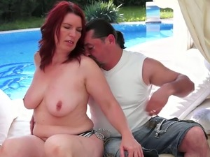 Mature redhead mom is getting her pussy eaten out outdoor