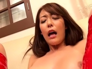 Kinky Oriental milf with big hooters takes a fist up her ass