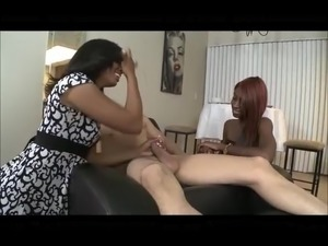 Two black girls suck a white guy
