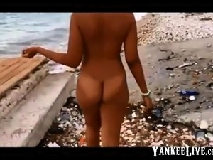 Twerking nude in public beach