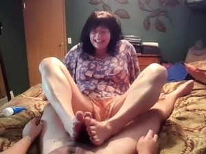 Sensual mature wife works her lovely feet on a cock in POV