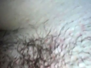Fingering hairy pussy in close up video