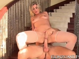 MILF getting sprayed with cum all over face after a fuck