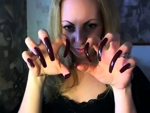 Mesmerizing amateur milf shows off her long nails on webcam