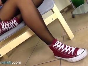 Teen Brunette in black pantyhose and Converse All Star shoes