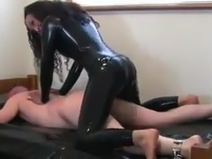 Latex woman shows him the correct way