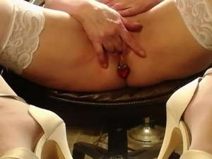 Playing in heels with fingers and jewels