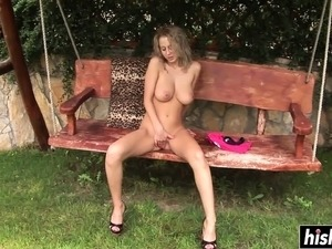 Solo girl plays with a long dildo