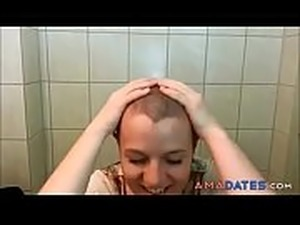 sexy redhead shaves her head bald