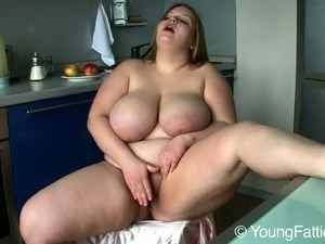 Lovely BBW Suzie with huge juggs masturbates in the kitchen every morning