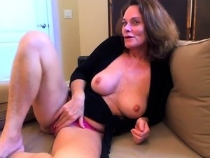 Busty mature brunette peels off her panties and masturbates