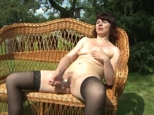 Horny Dutch mature woman passionately dildoing herself outdoors