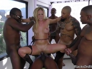 A group of of black guys gangbang and jizz all over a white MILF