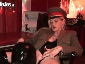 Hot mistress in knee high heel latex boots punishes her slave